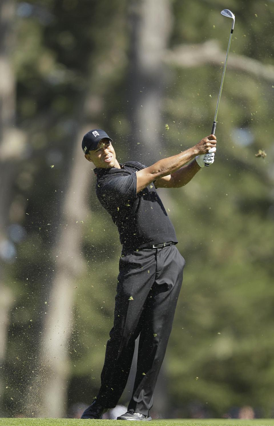 Tiger Woods hits a shot on the 11th hole during the second round of the U.S. Open Championship golf tournament Friday, June 15, 2012, at The Olympic Club in San Francisco. (AP Photo/Eric Risberg)