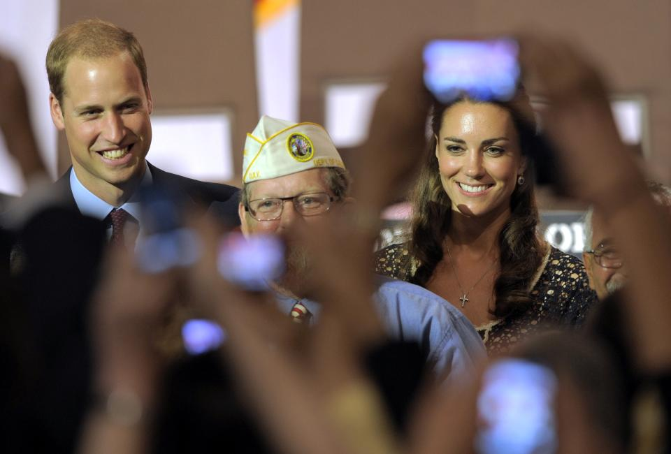 "Prince William and Kate, the Duke and Duchess of Cambridge, mingle with the crowd at the Service Nation: Mission Serve ""Hiring Our Heroes Los Angeles"" job fair event at Sony Pictures Studios in Culver City, Calif., Sunday, July 10, 2011. (AP Photo/Chris Pizzello)"