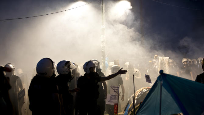 FILE - In this file Saturday, June 15, 2013, file photo, riot police gather in Gezi park, engulfed in tear gas, in Istanbul, Turkey. Protesters set up barricades as plumes of tear gas rose in Istanbul's streets into the early hours Sunday. (AP Photo/Vadim Ghirda, file)