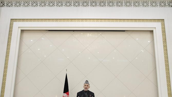 Afghan President Hamid Karzai speaks during a press conference at the presidential palace in Kabul, Afghanistan, Sunday, Feb. 26, 2012. Afghanistan's president renewed his calls for calm on Sunday in a televised address to the nation after the burning of Qurans at a U.S. base sparked five days of deadly protests and prompted the international military coalition to pull its advisers from Afghan ministries out of fear that they would become the next targets. (AP Photo/Musadeq Sadeq)