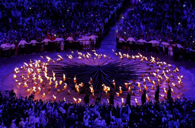 The stems forming the Olympic Cauldron are lit by seven young athletes during the opening ceremony of the London 2012 Olympic Games at the Olympic Stadium