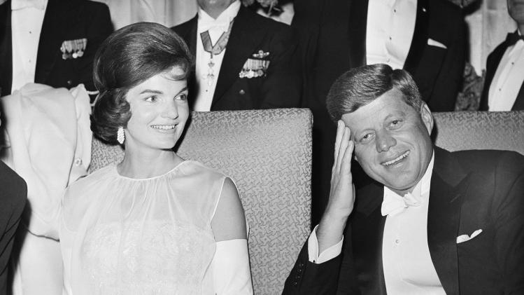 FILE - This Jan. 20, 1961 file photo shows President John F. Kennedy and first lady Jacqueline Kennedy as they attend one of five inaugural balls in Washington.  Kenneth Battelle, the hairdresser who gave both Jackie Kennedy and Marilyn Monroe their calling-card hairdos in the 1950s and '60s, died at his home in Wappinger's Falls, N.Y. on Sunday, May 12, 2013. He was 86.  Battelle made a splash in the worlds of fashion, celebrity and socialites with his style of movement and shine, instead of the stiffer looks that had been popular with the previous generation.  (AP Photo, file)