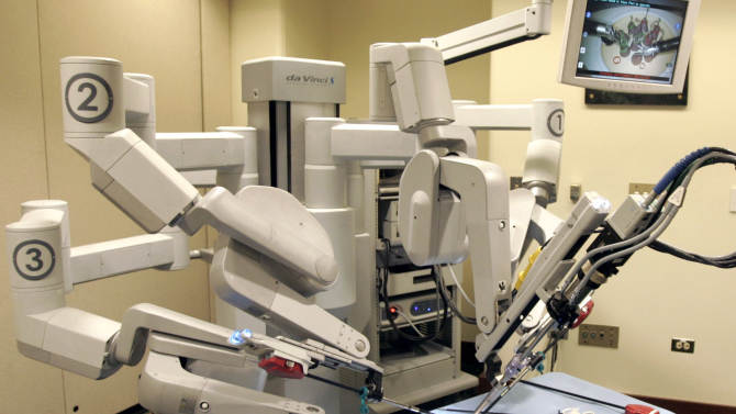 FILE - This Friday, June 13, 2008 file photo shows the da Vinci Surgical Robot at a hospital in Pittsburgh. Pricey robotic surgery shouldn't be the first or even second choice for most women who need a hysterectomy, says advice issued Thursday, March 14, 2013 to doctors who help those women decide. (AP Photo/Keith Srakocic)