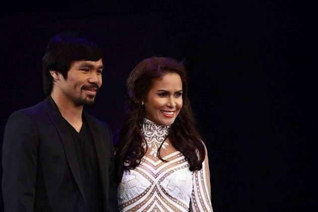 Boxing champion Manny Pacquiao with wife Jinkee, takes to the runway during the Bench Universe Denim and Underwear Show at the SM Mall of Asia in Pasay City Sept. 14. (Mike Alquinto, NPPA Images)