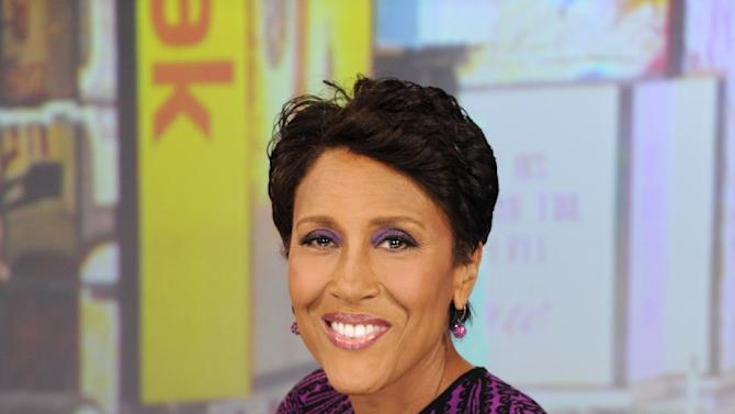 """This image released by ABC shows co-host Robin Roberts wearing an armband that covers her pic line chemotherapy treatment, on """"Good Morning America,"""" Tuesday, June 26, 2012 in New York. A national bone marrow donation registry says the rate of new registrants has more than doubled since ABC News' Robin Roberts said that she'll need a transplant. The """"Good Morning America"""" anchor is being treated for MDS, a blood and bone marrow disease. She will require a transplant this fall.  (AP Photo/ABC, Ida Mae Astute)"""