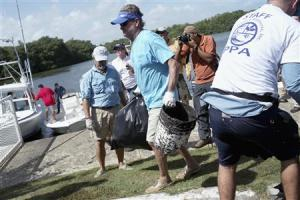 """U.S. artist and conservationist Harvey leads group of volunteers along San Juan estuary system for second """"mega cleanup"""" of garbage from waterway, in San Juan"""