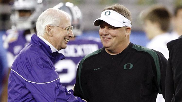 Kansas State head coach Bill Snyder, left, shakes hands with Oregon head coach Chip Kelly before the Fiesta Bowl NCAA college football game, Thursday, Jan. 3, 2013, in Glendale, Ariz. (AP Photo/Paul Connors)