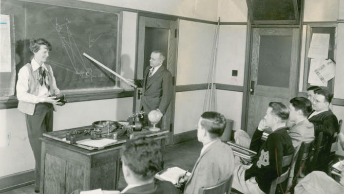 FILE -  This undated photo shows Amelia Earhart visting a Purdue classroom for aerodynamics students.   Earhart was a lecturer at the school from fall of 1935 until her 1937 disappearance.    Three bone fragments found on a deserted South Pacific island are being analyzed to determine if they belong to Amelia Earhart _ tests that could finally prove she died as a castaway after failing in her 1937 quest to become the first woman to fly around the world.  (AP Photo/Purdue University Libraries, Archives and Special Collections, The Journal & Courier)  NO SALES