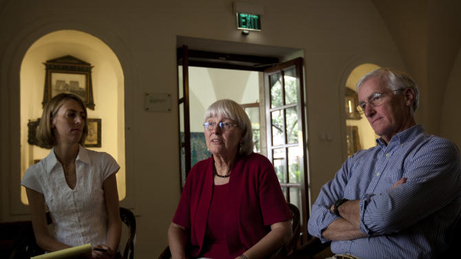 Cindy, center, and Craig Corrie, right, the parents of Rachel Corrie, a pro-Palestinian activist who was killed by an Israeli bulldozer in Gaza in 2003, sit together with their daughter Sarah, during an interview with the Associated Press in Jerusalem, Sunday, Aug. 26, 2012. Almost a decade after their daughter was crushed to death by an Israeli army bulldozer as she tried to block its path in a Gaza Strip war zone, Rachel Corrie's parents are bracing for the judge's ruling in their high-profile civil lawsuit against the military. (AP Photo/Sebastian Scheiner)