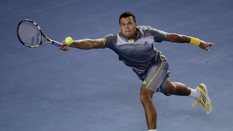 France's Jo-Wilfried Tsonga makes a forehand return to Switzerland's Roger Federer during their quarterfinal match at the Australian Open tennis championship in Melbourne, Australia, Wednesday, Jan. 23, 2013.  (AP Photo/Dita Alangkara)