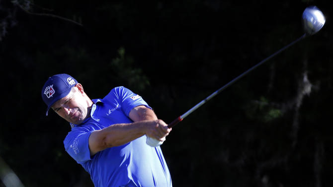 Padraig Harrington, of Ireland, watches his tee shot on the ninth hole during the first round of the McGladrey Classic golf tournament on Thursday, Oct. 23, 2014, in St. Simons Island, Ga. (AP Photo/Stephen B. Morton)