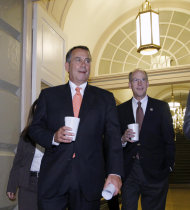"""<p>               House Speaker John Boehner of Ohio, followed by  Rep. Greg Walden, R-Ore., strides into a GOP strategy session singing """"Zip-a-Dee-Doo-Dah"""" on the morning after  lawmakers from both political parties came together on an 11th-hour deal to keep the government from shutting down, Friday, Dec. 16, 2011, on Capitol Hill in Washington.   (AP Photo/J. Scott Applewhite)"""