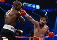 &lt;p&gt;Manny Pacquiao (R) during the WBO welterweight title fight against Timothy Bradley on June 9. Pacquiao is second on the Forbes 100 highest-paid athletes list at $62 million from earnings and endorsements.&lt;/p&gt;