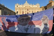Faithful hold a banner with picture of Pope Francis in St Peter's Square on March 19, 2013 at the Vatican. Hundreds of thousands of people are expected to turn out in for the inauguration of Latin America's first pontiff