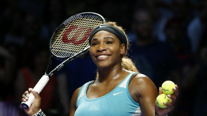 Serena Williams of the U.S. smiles to the crowd after defeating Eugenie Bouchard of Canada during WTA Finals singles tennis match at the Singapore Indoor Stadium