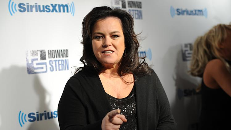 "FILE - This Jan. 31, 2014 file photo shows television personality Rosie O'Donnell attends ""Howard Stern's Birthday Bash,"" presented by SiriusXM, at the Hammerstein Ballroom in New York. The Tony Award's administration committee said Tuesday, April 1, that O'Donnell host will get the 2014 Isabelle Stevenson Award, given to a member of the theater community for philanthropic efforts. (Photo by Evan Agostini/Invision/AP, File)"