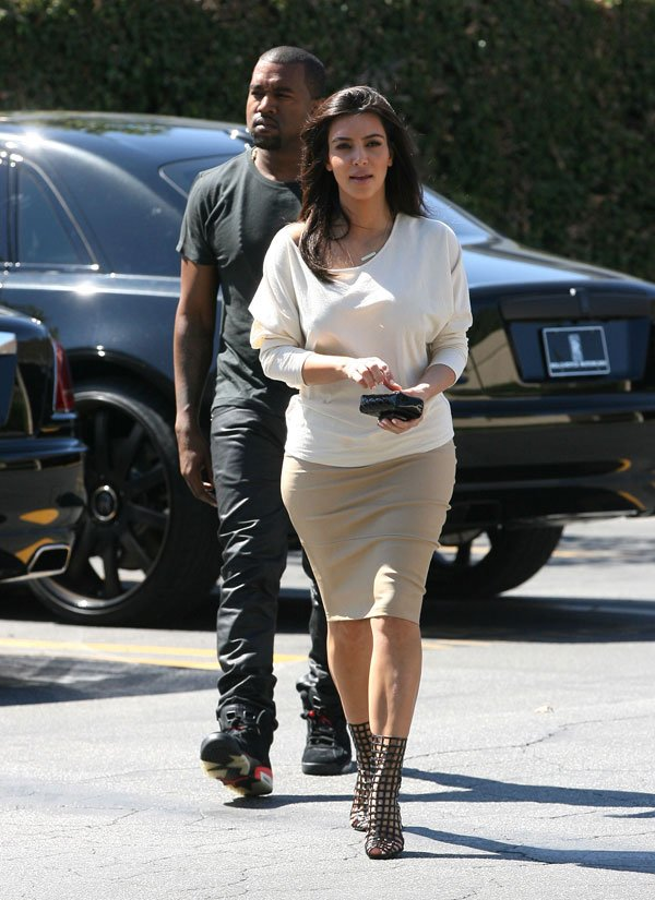 'KUWTK': Kanye West Lavishes Kim Kardashian With Racks Of Clothes