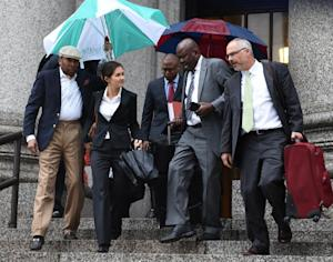 Attorneys Beatrice Lindstrom (2nd L) Marioa Joseph …