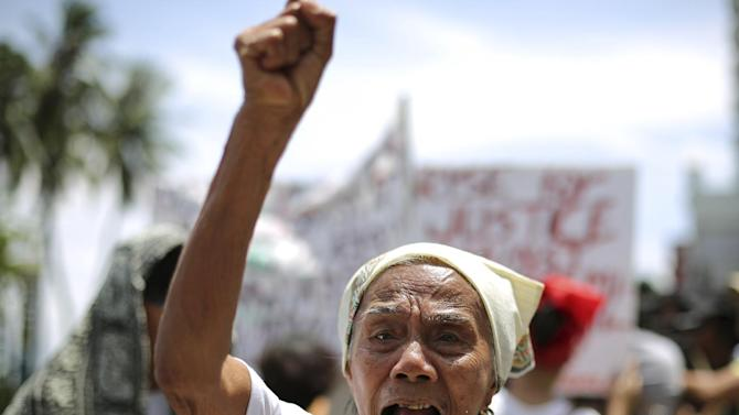 "Filipino Narcisa Claveria, 84, who claims to have been a sex slave during World War II, shouts slogans during a rally in front of the Japanese Embassy in Manila, Philippines Wednesday, June 25, 2014. A group of alleged Filipino ""comfort women"" demanded recognition following the announcement of the affirmation of the Kono Statement as a result of the Japanese government investigation on the alleged WWII sexual slavery in Korea. (AP Photo/Aaron Favila)"