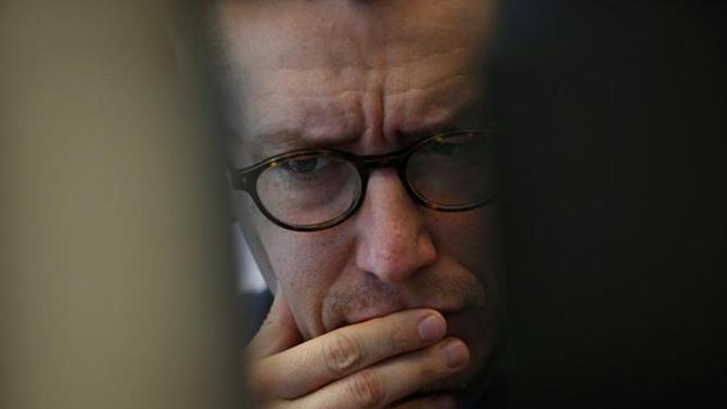 A trader reacts at Frankfurt stock exchange January 29, 2014. REUTERS/Ralph Orlowski