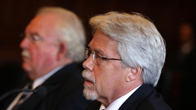 Mark Strong Sr., right, sits with his attorney Dan Lilley, left, during his arraignment Tuesday, Oct. 9, 2012 in Portland, Maine on 59 charges, including promotion of prostitution and violation of privacy in connection with a Kennebunk Zumba dance studio. Strong Jr. entered a plea of not guilty. (AP Photo/Joel Page)