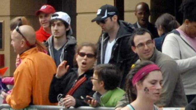 FILE - This Monday, April 15, 2013 photo provided by Bob Leonard shows Tamerlan Tsarnaev, third from left, who was dubbed Suspect No. 1 and second from left, Dzhokhar A. Tsarnaev, who was dubbed Suspect No. 2 in the Boston Marathon bombings by law enforcement. This image was taken approximately 10-20 minutes before the blast. (AP Photo/Bob Leonard)