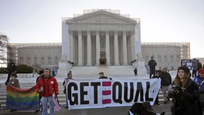Demonstrators stand outside the Supreme Court on March 26.