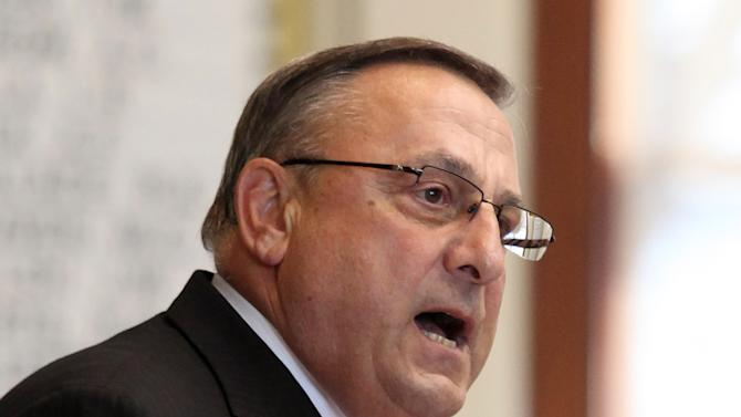 FILE - In this Dec. 5, 2012 file photo, Gov. Paul LePage speaks at the swearing in ceremony for new representatives at the State House in Augusta, Maine. As LePage addressed the newly elected Legislature in early December, his frustration with trackers, the video camera-toting operatives who follow politicians around, boiled over into a brief diatribe that set the session off to a sour start. (AP Photo/Joel Page, File)