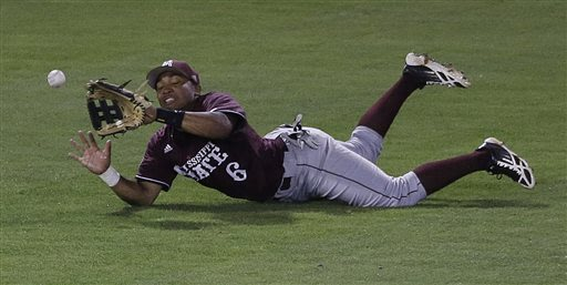 Mississippi State left fielder Derrick Armstrong cannot make the catch on a double hit by South Carolina's Chase Vergason in the seventh inning of their Southeastern Conference Tournament college base