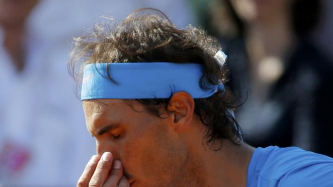 Rafael Nadal of Spain reacts during his men's quarter-final match against Novak Djokovic of Serbia during the French Open tennis tournament at the Roland Garros stadium in Paris