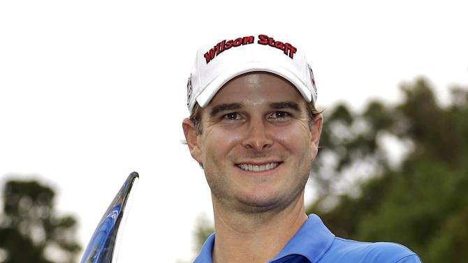 Kevin Streelman holds the trophy after winning the Tampa Bay Championship golf tournament, Sunday, March 17, 2013, in Palm Harbor, Fla. (AP Photo/Chris O'Meara)