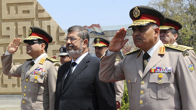 File photo of Egypt's President Mursi visiting the tomb of ex-President al-Sadat and the Tomb of the Unknown Soldier during the commemoration of Sinai Liberation Day in Cairo