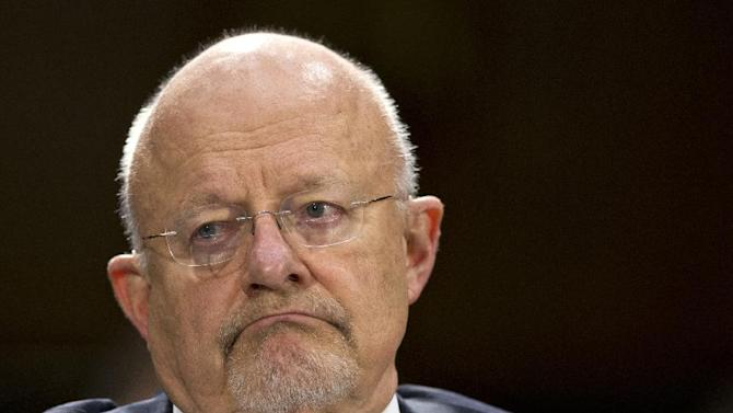 """FILE - In this April 18, 2013 file photo, National Intelligence Director James Clapper prepares to testify on Capitol Hill in Washington. When the federal government went looking for phone numbers tied to terrorists, it grabbed the records of just about everyone in America. Why every phone number? """"Well, you have to start someplace,"""" Director of National Intelligence James Clapper told NBC News on Monday. (AP Photo/J. Scott Applewhite, File)"""