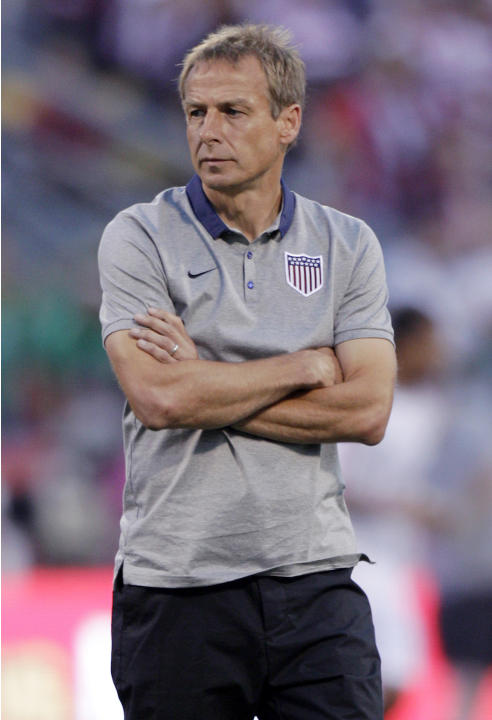 United States manager Jurgen Klinsmann watches his team warm before their World Cup qualifying soccer match against Mexico Tuesday, Sept. 10, 2013, in Columbus, Ohio