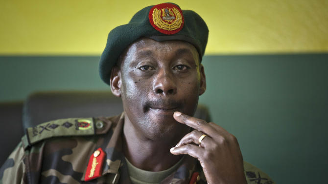 In this photo taken Monday, April 30, 2012, Commander of the Uganda People's Defence Force (UPDF) Gen. Aronda Nyakairima speaks to the media near Kampala, Uganda. Uganda's president Yoweri Museveni fired his top military commander Nyakairima on Friday, May 24, 2013 when he was appointed minister of internal affairs, effectively cutting his links to the army's chain of command, the ouster apparently linked to turmoil over Museveni's alleged plan to have his son succeed him as head of state. (AP Photo/Ben Curtis)