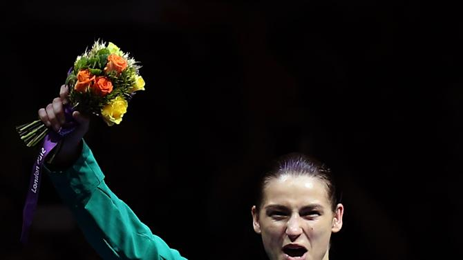 Gold medalist, Katie Taylor from Ireland,  participates in the a medals ceremony for women's lightweight 60-kg boxing at the 2012 Summer Olympics, Thursday, Aug. 9, 2012, in London. (AP Photo/Hassan Ammar)