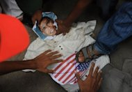 Pakistani protesters beat an effigy of the US President Barack Obama during a rally in Karachi against an anti-Islam movie. The Pakistani Taliban have issued a call for Muslims worldwide and within the country to rise up against an anti-Islam movie. Washington has deployed anti-terror forces to cope with a wave of global violence over a film mocking Islam