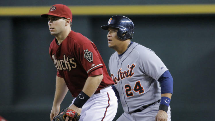 Detroit Tigers' Miguel Cabrera (24) and Arizona Diamondbacks' Paul Goldschmidt watch a pitch during the fourth inning of a baseball game on Wednesday, July 23, 2014, in Phoenix. (AP Photo/Matt York)