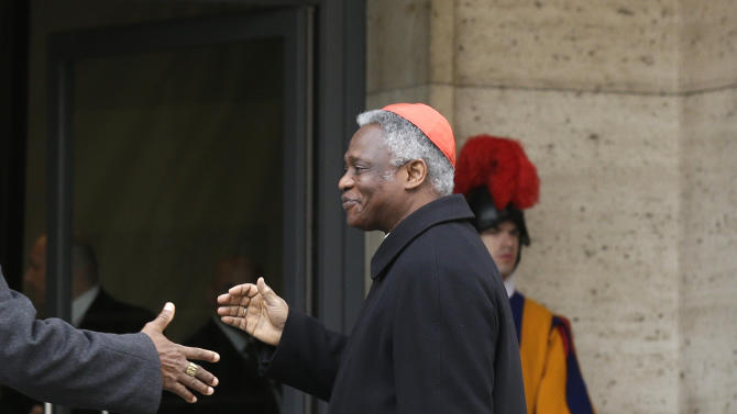 Cardinal Peter Kodwo Appiah Turkson arrives for a meeting at the Vatican, Friday, March 8, 2013. The last cardinal who will participate in the conclave to elect the next pope arrived in Rome on Thursday, meaning a date can now be set for the election. One U.S. cardinal said a decision on the start date is expected soon. (AP Photo/Alessandra Tarantino)