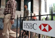Pedestrians walk past an HSBC sign outside the bank&#39;s Indian head office in Mumbai in 2011. India said Thursday it was seeking details of a report that banking giant HSBC allowed overseas affiliates to move billions of dollars in suspect funds in the United States without adequate controls