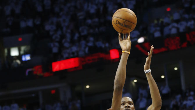 Oklahoma City Thunder forward Kevin Durant (35) shoots in front of Memphis Grizzlies guard Tony Allen (9) in the second half of Game 5 of their Western Conference Semifinals NBA basketball playoff series in Oklahoma City, Wednesday, May 15, 2013. Memphis won 88-84. (AP Photo/Sue Ogrocki)
