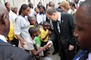 United Nations Secretary-General Ban Ki-moon greets children as he visits the Heal Africa hospital in Goma, eastern Congo, Thursday, May 23, 2013. Ban arrived Thursday in Goma, hours after a rebel group fighting government forces nearby said they would impose a cease-fire to allow the visit to proceed. The M23 rebels and the Congolese army began fighting three days ago just north of Goma, ending a nearly six-month-long truce.(AP Photo/Alain Wandimoyi)