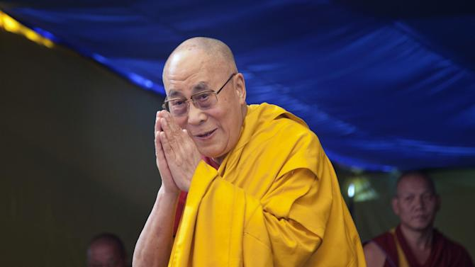 Tibetan spiritual leader the Dalai Lama greets devotees as he arrives to give a religious talk at the Tibetan Children's Village School in Dharmsala, India, Wednesday, May 27, 2015. Every year Dalai Lama gives teachings to young Tibetans at the school. (AP Photo/Ashwini Bhatia)