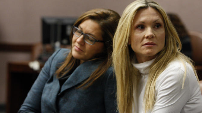 """Attorney Ellen Torregrossa-O'Connor, left, holds the hand of  former """"Melrose Place"""" actress Amy Locane-Bovenizer, 40, of Hopewell Township, N.J. as the jury in her trial returns a verdict on Tuesday, Nov. 27, 2012 in Somerville, N.J.   The jurors convicted Locane-Bovenizer of vehicular homicide, but acquitted her of a more serious charge, aggravated manslaughter, in the 2010 accident that killed a 60-year-old woman. Somerset County prosecutors said Locane-Bovenizer's blood-alcohol level was nearly three times the legal limit when the crash occurred on a dark two-lane road in Montgomery Township. The defence conceded she was driving under the influence. But her lawyer claimed a woman was chasing her after an earlier accident, forcing her to speed.  (AP Photo/The Star-Ledger, Robert Sciarrino, Pool)"""