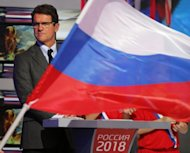 Fabio Capello attends a ceremony in Moscow last month devoted to the 2018 World Cup host cities. The Russia coach says he intends to reverse the squad's knack for losing big matches by taking the game to Portugal during their top-of-the-table 2014 World Cup qualifier in Moscow