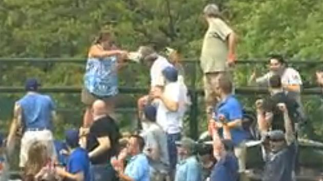 Wife drenches husband with beer after he tries to protect her from baseball