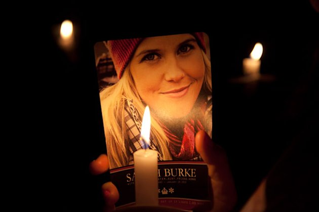 A lit candle lights up a picture of freestyle skier Sarah Burke (Canadian Press)