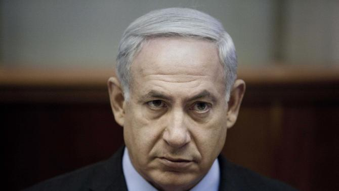 """Israeli Prime Minister Benjamin Netanyahu chairs the weekly cabinet meeting at the Prime Minister's Office in Jerusalem, Sunday, Aug. 12, 2012. With attack rhetoric heating up, Israel's prime minister says the threat from Iran dwarfs all others. Netanyahu told his Cabinet on Sunday, """"Iran must not be allowed to obtain nuclear weapons."""" (AP Photo/Abir Sultan, Pool)"""