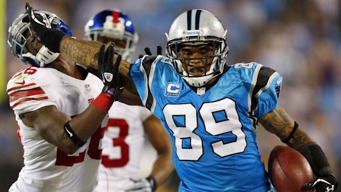 Carolina Panthers wide receiver Steve Smith (89) stiff-arms New York Giants safety Antrel Rolle (26) during the fourth quarter of an NFL football game in Charlotte, N.C., Thursday, Sept. 20, 2012. The Giants won 36-7. (AP Photo/Bob Leverone)