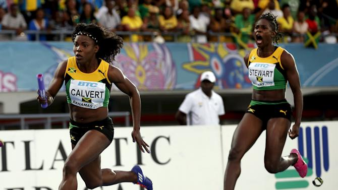 Jamaica's Kerron Stewart screams at teammate Schillone Calvert after passing her the baton on their way to winning the women's 4x4100 relay race at the IAAF World Relays Championships in Nassau